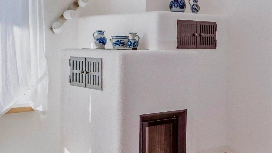 Appartement A - Wohnzimmer mit Kamin